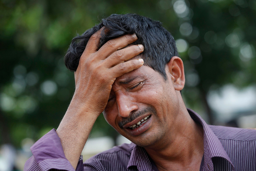 . A man mourns for his relative, a garment worker who had died in the collapse of the Rana Plaza building, in Savar, around 30 km (19 miles) outside Dhaka April 30, 2013.  REUTERS/Andrew Biraj