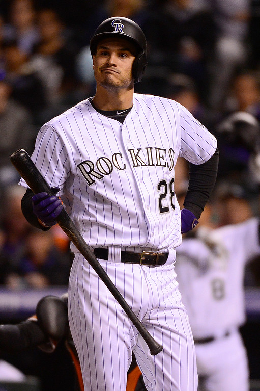 . DENVER, CO - APRIL 12: Colorado Rockies third baseman Nolan Arenado (28) makes a face after making his second strike during the fourth inning at Coors Field on April 12, 2016 in Denver, Colorado. (Photo by Brent Lewis/The Denver Post)
