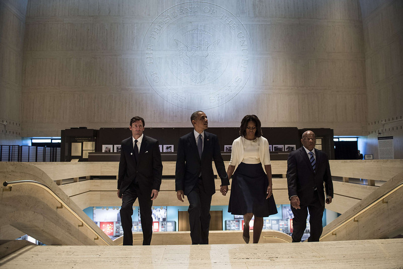 . US President Barack Obama (2L), US first lady Michelle Obama (2R) and Rep. John Lewis(R) ,D-GA, tour the great hall of the Lyndon B. Johnson Presidential Library with Mark Updegrove, Director of the LBJ Presidential Library, April 10, 2014 in Austin, Texas. Obama is attending a Civil Rights Summit to celebrate the 50th anniversary of the Civil Rights Act of 1964.  (BRENDAN SMIALOWSKI/AFP/Getty Images)