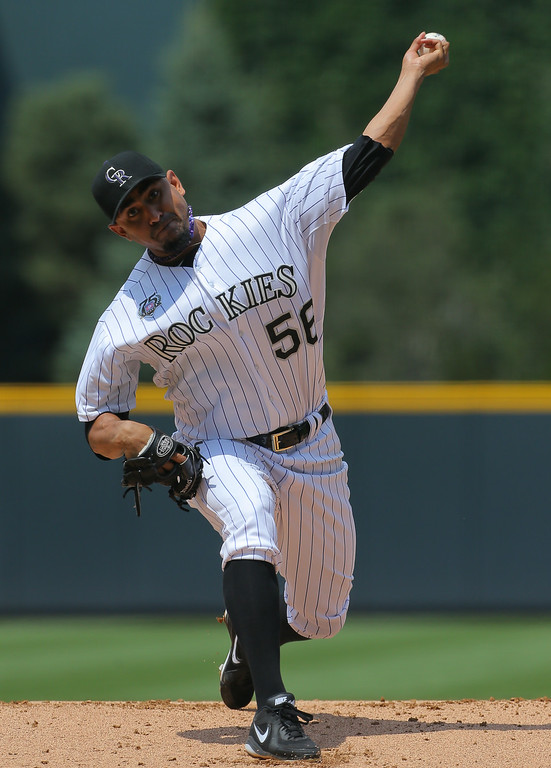 . Starting pitcher Franklin Morales #56 of the Colorado Rockies delivers to home plate during the first inning against the Pittsburgh Pirates at Coors Field on July 27, 2014 in Denver, Colorado.  (Photo by Justin Edmonds/Getty Images)