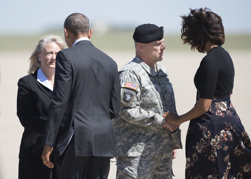 . US President Barack Obama  (2L) and US First Lady Michelle Obama (R) are greeted by Army Lt. General Mark Milley (2R) his wife Hollyanne Milley (L) at Robert Gray Army Airfield on April 9, 2014 in Killeen, Texas.   AFP PHOTO/Brendan  SMIALOWSKI/AFP/Getty Images