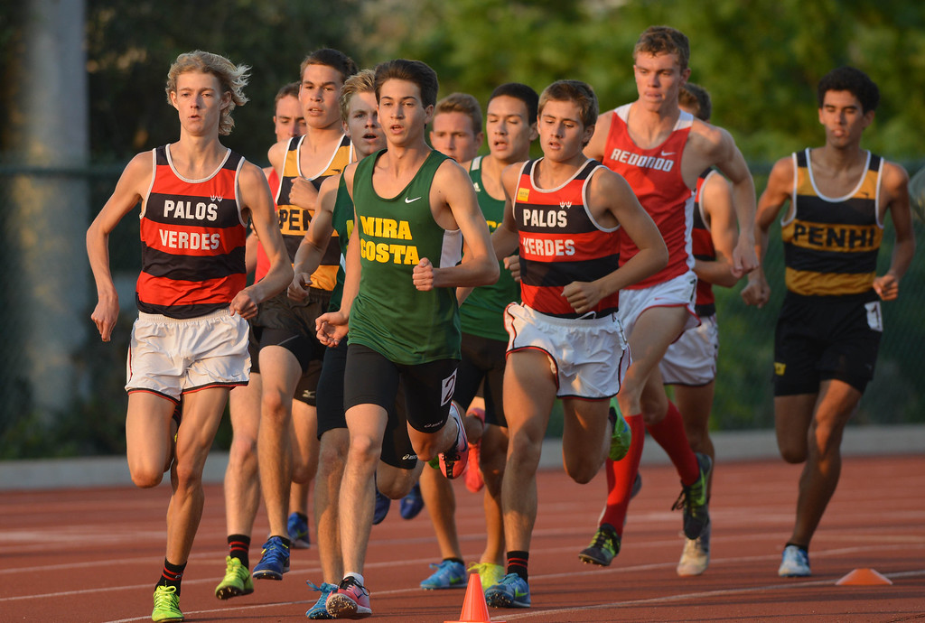 . 05-03-2013-(LANG Staff Photo by Sean Hiller)-  The Bay League track and field finals Friday night at Mira Costa High School. The boys varsity 1600 meter run head out in a tight pack.