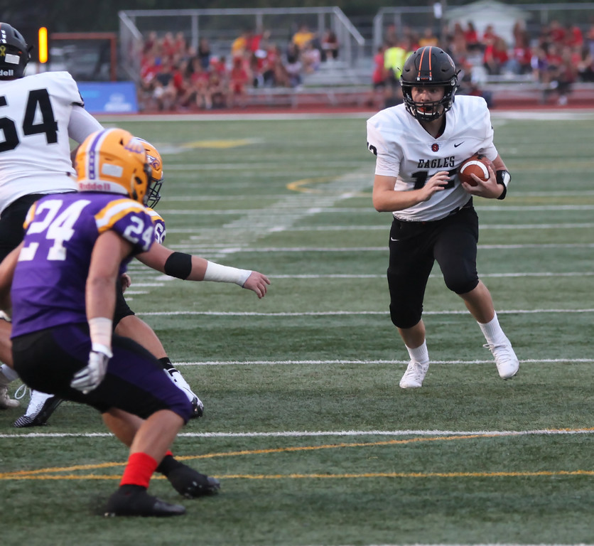 . Randy Meyers - The Morning Journal<br> North Olmsted quarterback Liam Fay finds a big hole in the Avon defense on a gain during the first quarter on Sept. 14.