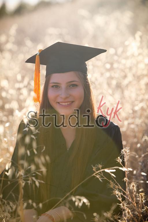Congrats Graduate <br /> I have a  black Cap and Gown  at the studio