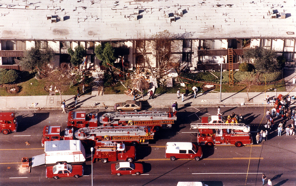 . Fire and rescue vehicles fill the street in front of the Northridge Meadows apartment complex as the grim search for victims goes on inside.   Los Angeles Daily News file photo