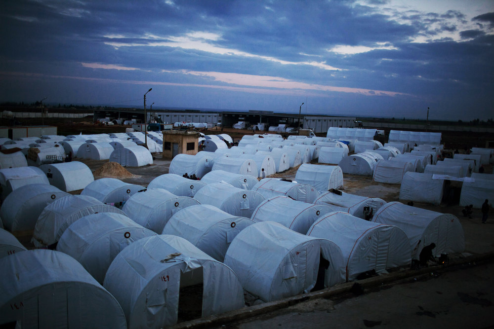 Description of . General view of a refugee camp near the Turkish border, in Azaz, Syria, Sunday, Dec. 9, 2012. (AP Photo/Manu Brabo)