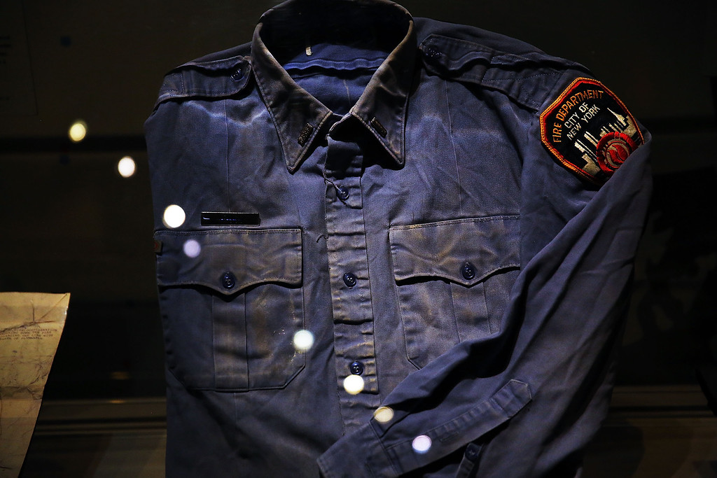 . A firefighters shirt used at Ground Zero on September 11 is viewed during a tour the National September 11 Memorial Museum on May 14, 2014 in New York City.   (Photo by Spencer Platt/Getty Images)