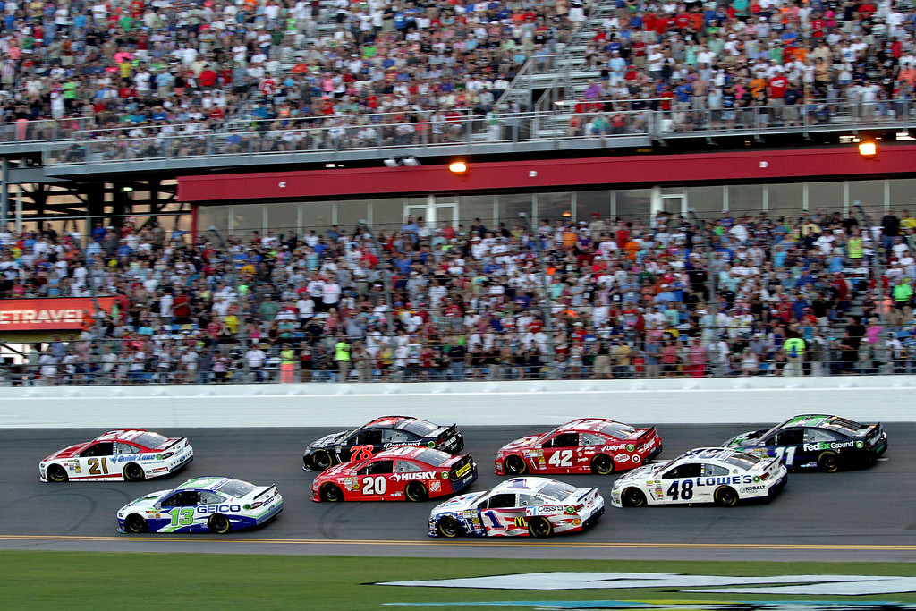 . DAYTONA BEACH, FL - JULY 06:  Trevor Bayne, driver of the #21 Motorcraft / Quick Lane Tire & Auto Center Ford, leads a pack of cars during the NASCAR Sprint Cup Series Coke Zero 400 at Daytona International Speedway on July 6, 2013 in Daytona Beach, Florida.  (Photo by Jerry Markland/Getty Images)