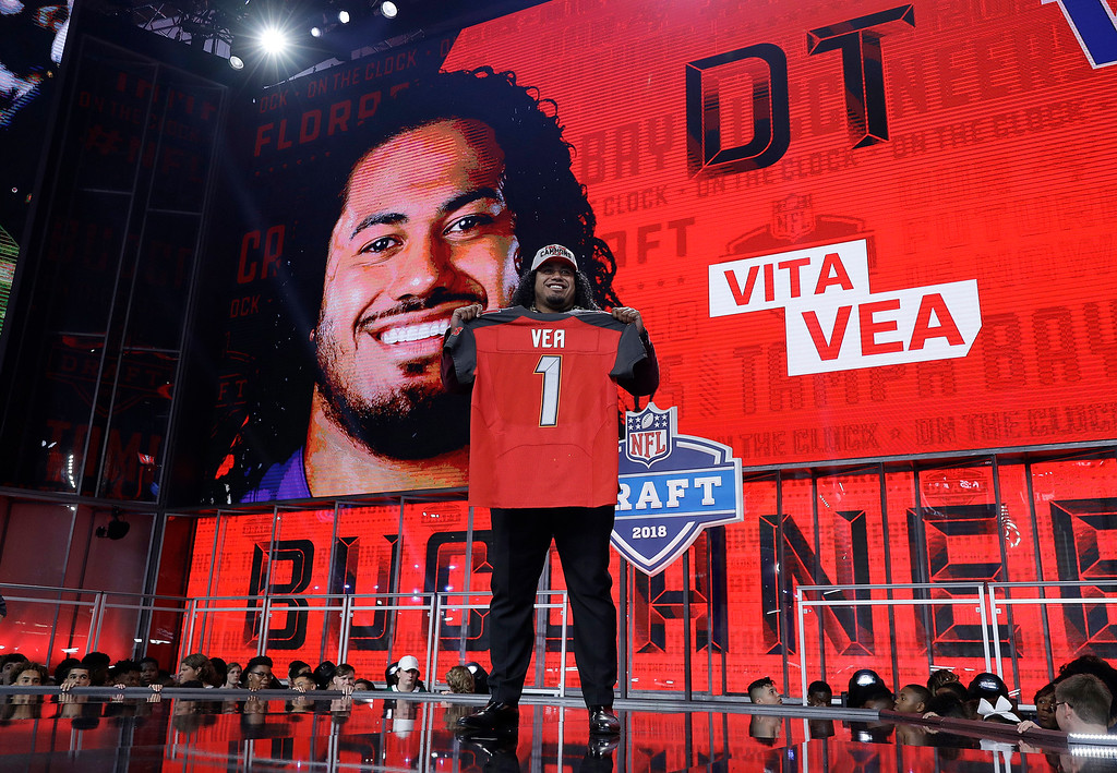 . Washington\'s Vita Vea holds his Tampa Bay Buccaneers jersey during the first round of the NFL football draft, Thursday, April 26, 2018, in Arlington, Texas. (AP Photo/David J. Phillip)