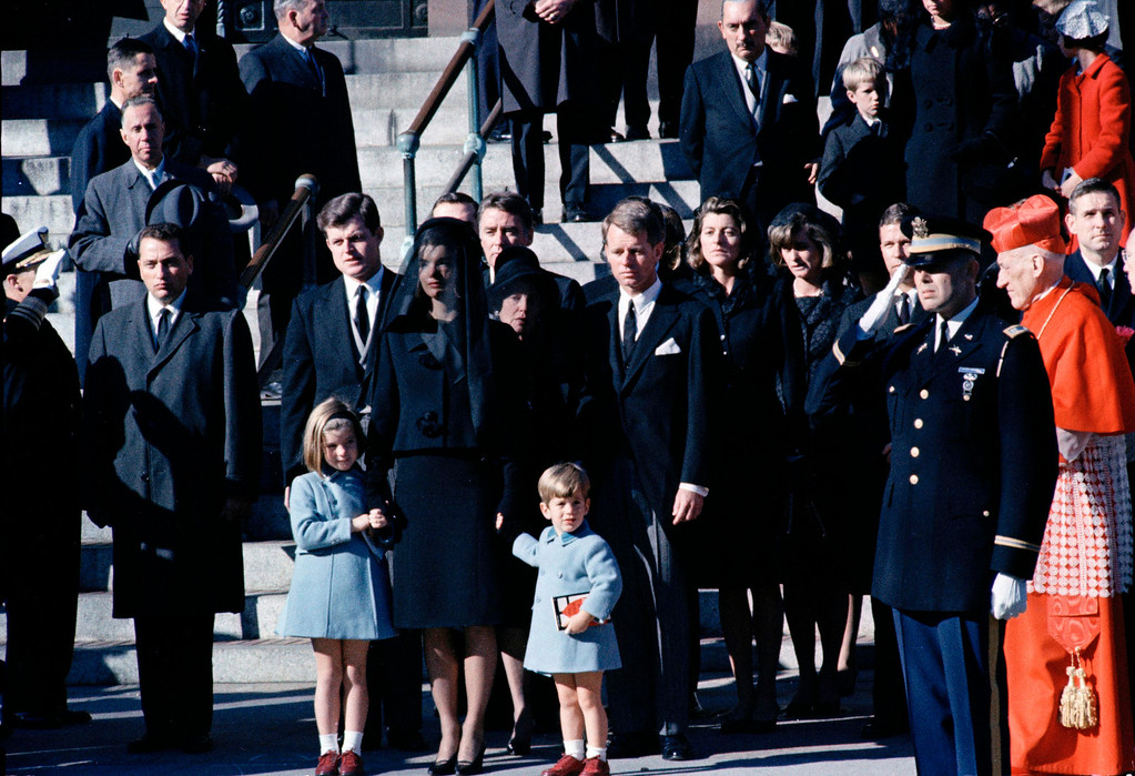 . Jacqueline Kennedy, widow of slain President John F. Kennedy, holds her children\'s hands outside St. Matthew\'s Cathedral in Washington, after funeral Mass for the president, Nov. 25, 1963. In front, from left: Caroline, Jacqueline and John F. Kennedy Jr.  Behind them are the president\'s brothers, Sen. Edward M. Kennedy (D-Mass.), left, and Attorney General Robert F. Kennedy.   (AP Photo)