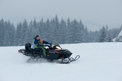 People enjoying snowmobile ride on Gubalowka Hill, Zakopane, Tatra Mountains, Podhale Region, Poland