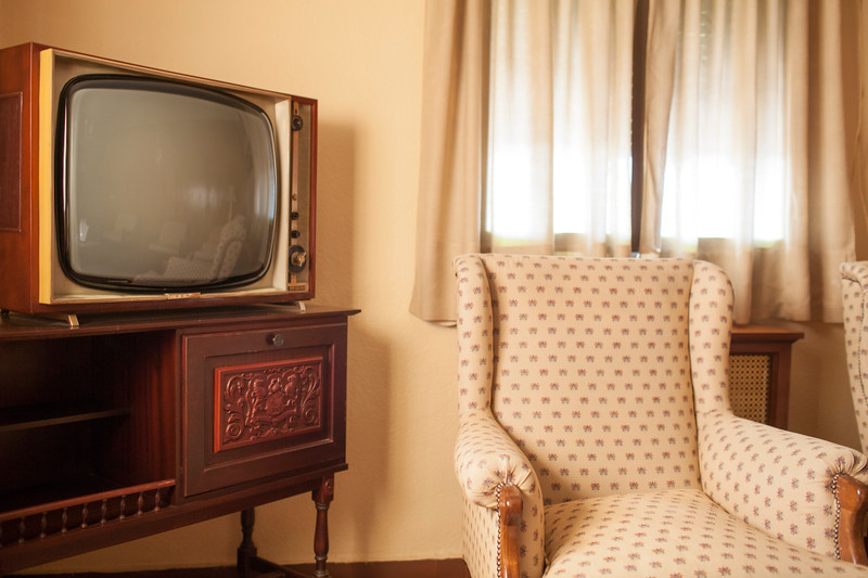 Vintage TV in an old fashioned hotel room, Guadalara, Spain