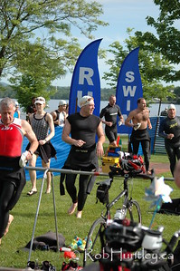 2009 Ottawa Riverkeeper Triathlon. Swimmers entering the transition area where they will quickly change to cycling gear and start the bicycling stage.  © Rob Huntley