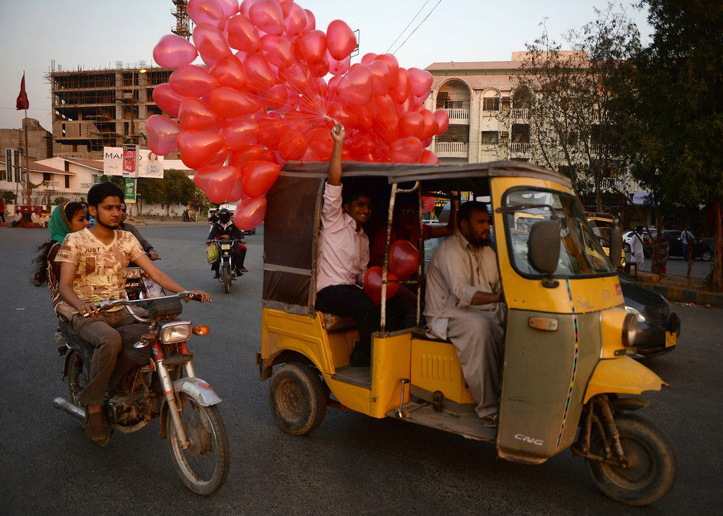 . A Pakistani boy holds heart-shaped balloons as he sits in rickshaw in Karachi on February 14, 2014, on the Valentine\'s Day . At least three students were wounded Friday in a clash at a university in the northwestern Pakistani city of Peshawar, following a dispute over Valentine\'s Day celebrations in the deeply Muslim country, police said. AFP PHOTO/Asif HASSAN/AFP/Getty Images