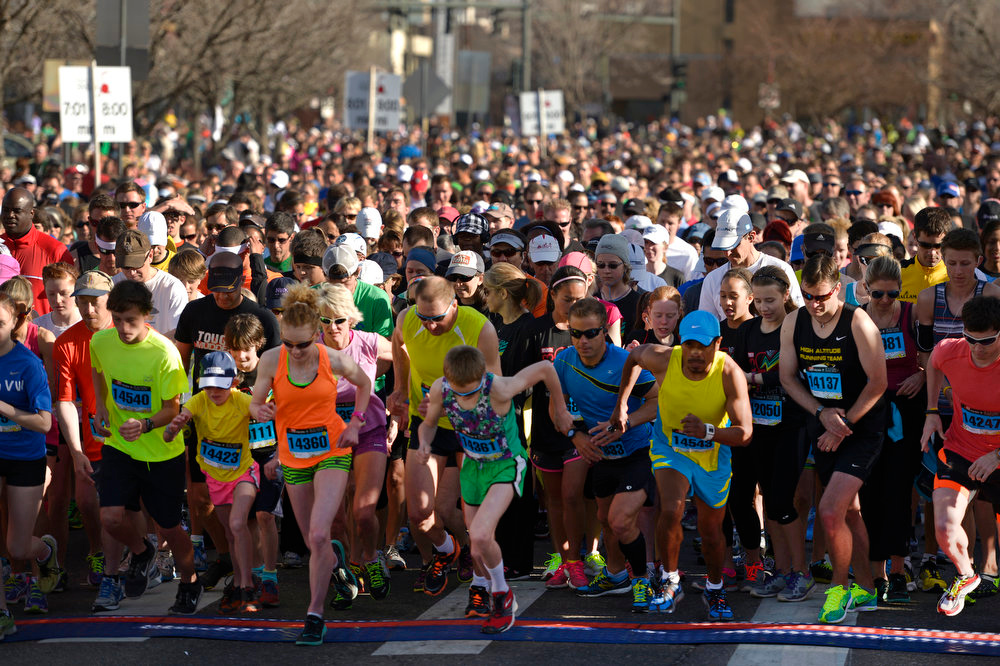 . Runners take off at the start of the 5K race.  The 31st annual Cherry Creek Sneak had all sorts of distances for this year\'s race.  The Sneak, as it is affectionately named, had a 10 mile, 5 mile, 3.1 mile or 5K, a 1.5 mile Denver\'s 7 Sprint, and a kid\'s fun run for thousands of competitors, runners and walkers that turned out in the Cherry Creek neighborhood of Denver, CO on April 28, 2013.  The race is always held the last Sunday in April. This year participants cheered the national anthem and observed a moment of silence for victims of the Boston Marathon bombing at the start of each race. (Photo by Helen H. Richardson/The Denver Post)