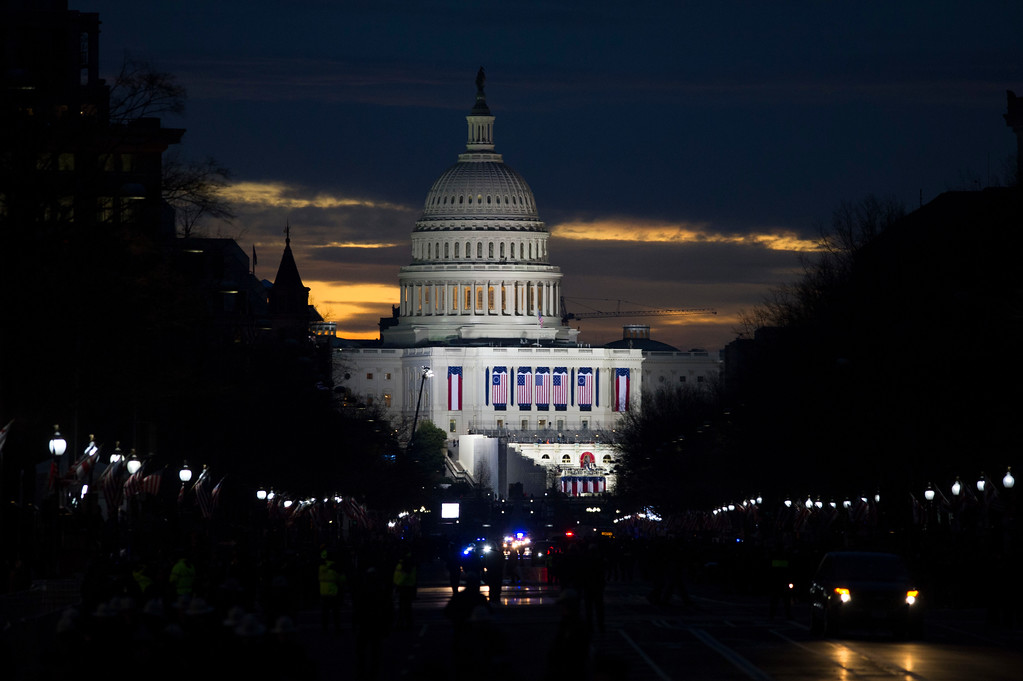 . The sun rises behind the Capitol in Washington, Friday, Jan. 20, 2017, where Donald Trump will be sworn-in as the 45th President of the United States. (AP Photo/Cliff Owen)