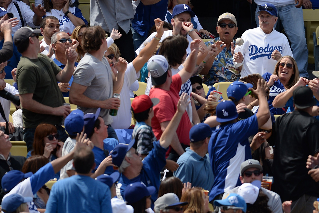 . A fly ball lands in the stands during the Dodger home opener at Dodger Stadium Friday 4, 2014. The Giants beat the Dodgers 8-4.  (Photo by Hans Gutknecht/Los Angeles Daily News)