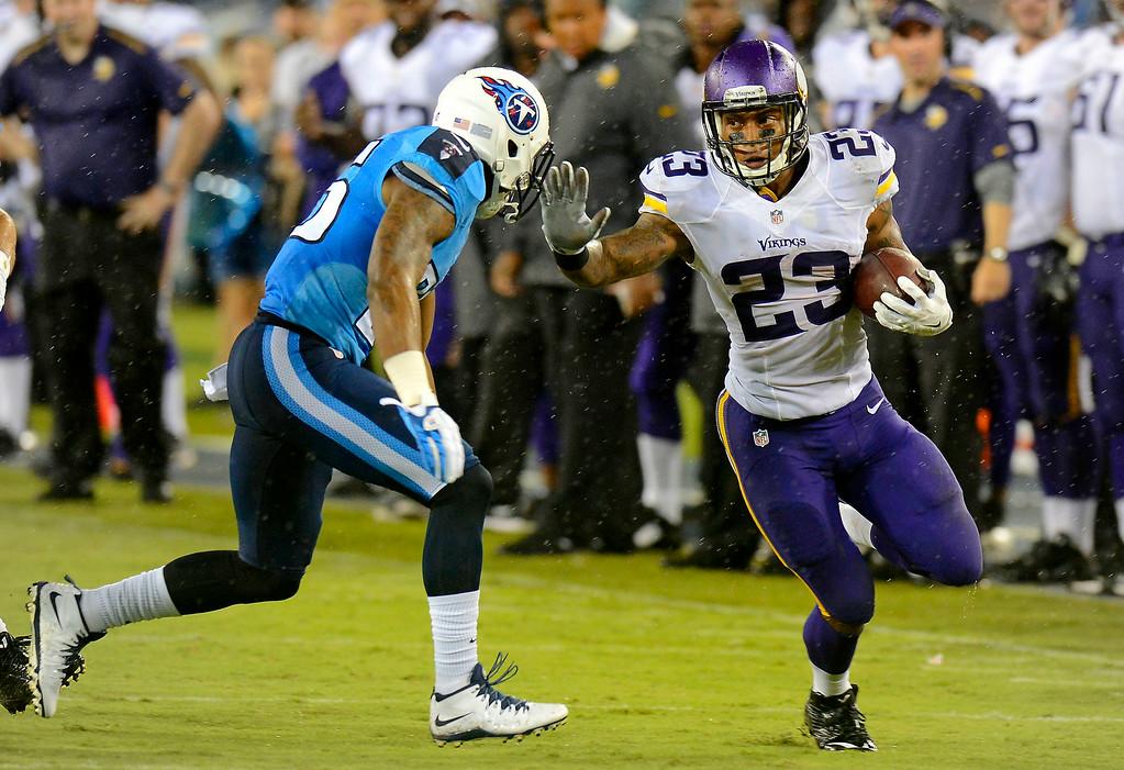 . Minnesota Vikings running back Joe Banyard tries to get past Tennessee Titans cornerback Khalid Wooten, left, in the second quarter. (AP Photo/Mark Zaleski)