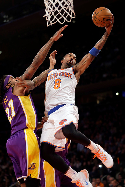 . New York Knicks\' J.R. Smith, right, goes for a basket over Los Angeles Lakers\' Jordan Hill during the second half of an NBA basketball game at Madison Square Garden, Sunday, Jan. 26, 2014, in New York. The Knicks won 110-103. (AP Photo/Seth Wenig)