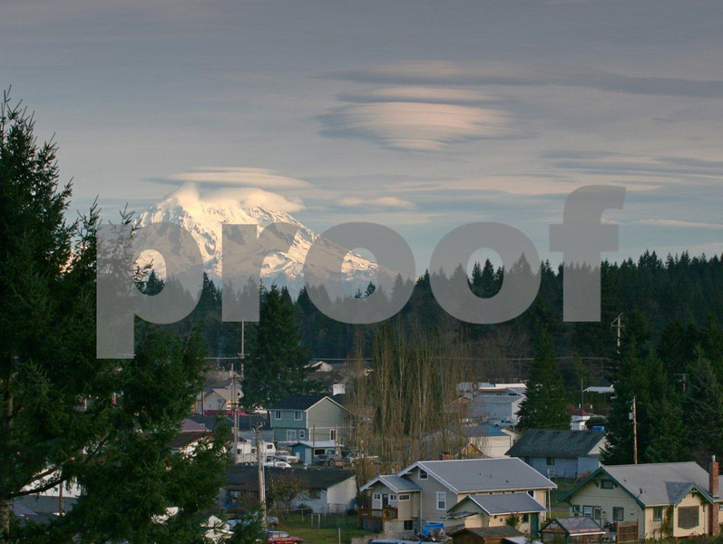 Mt. Rainier with its lenticular cloud formation as seen from the town of Rainier, WA