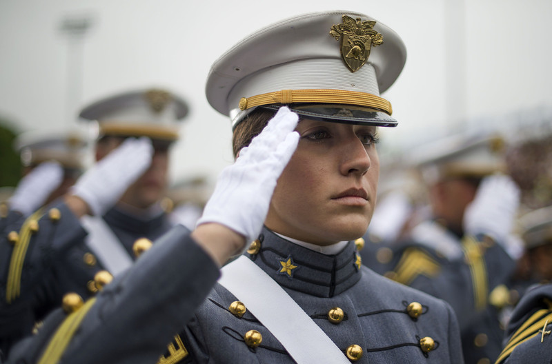 . A female cadet salutes as US President Barack Obama arrives deliver the commencement address to the 2014 graduating class at the United States Military Academy at West Point, New York, May 28, 2014.  (JIM WATSON/AFP/Getty Images)