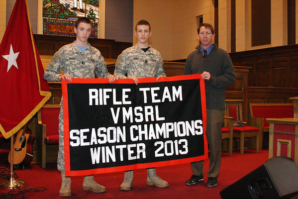 Varsity Rifle displays 2013 Winter Champs Banner
