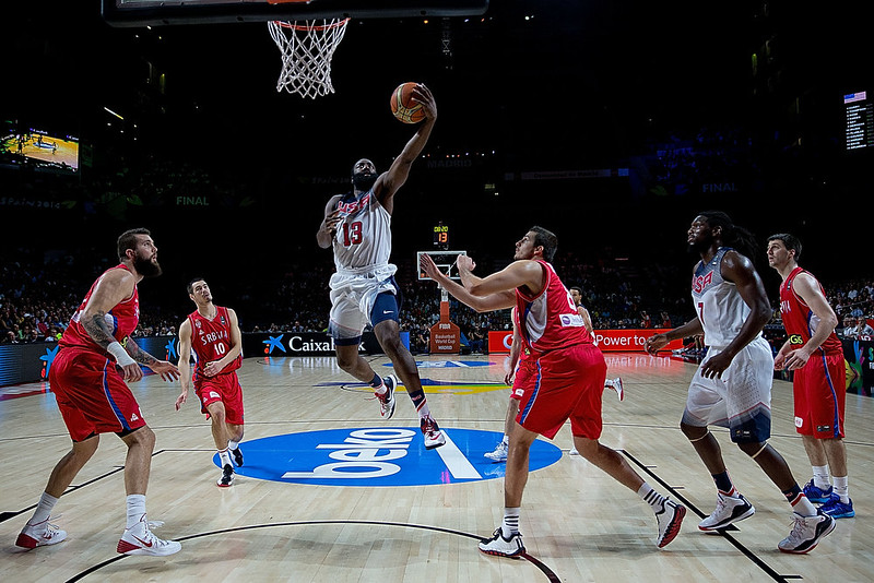 . James Harden (3dL) of the USA shoots against Nemanja Bjelica (R) of Serbia during the 2014 FIBA World Basketball Championship final match between USA and Serbia at Palacio de los Deportes on September 14, 2014 in Madrid, Spain. (Photo by Gonzalo Arroyo Moreno/Getty Images)