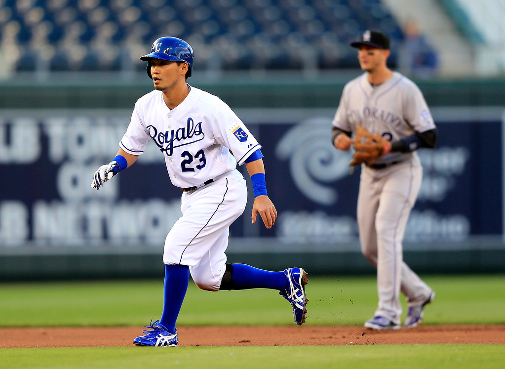 . Norichika Aoki #23 of the Kansas City Royals leads off second base as Troy Tulowitzki #2 of the Colorado Rockies watches the pitch during the 1st inning of the game at Kauffman Stadium on May 13, 2014 in Kansas City, Missouri.  (Photo by Jamie Squire/Getty Images)