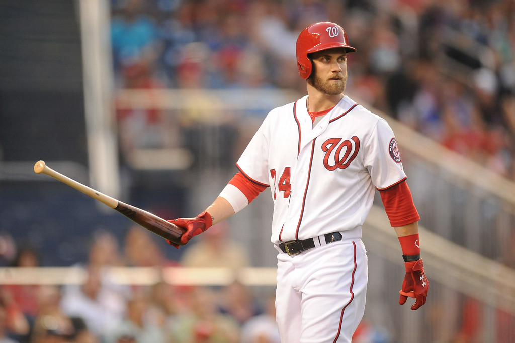 . Bryce Harper #34 of the Washington Nationals walks back to the dugout after striking out in the third inning during a baseball against the Colorado Rockies on July 1, 2014 at Nationals Park in Washington, DC.  (Photo by Mitchell Layton/Getty Images)