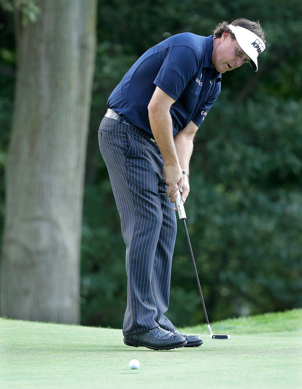 . Phil Mickelson misses his putt on the 14th hole during the final round of the PGA Championship golf tournament at Oak Hill Country Club, Sunday, Aug. 11, 2013, in Pittsford, N.Y. (AP Photo/Charlie Riedel)