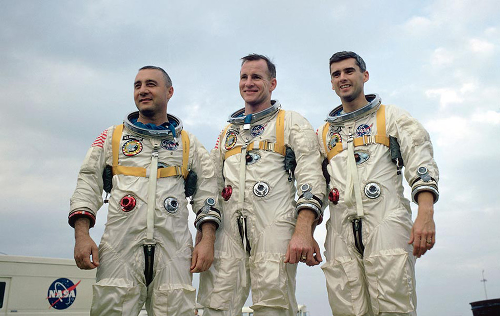 """. FILE - This undated file photo provided by NASA shows the Apollo 1 crew at an undisclosed location. From left:  astronauts Virgil \""""Gus\"""" Grissom, Edward H. White II and Roger B. Chaffee. All three perished after a fire broke out inside the Apollo 1 module during a launch rehearsal on Jan. 27, 1967,  at the Cape Canaveral Air Force Station, Fla. (AP Photo/NASA, File)"""
