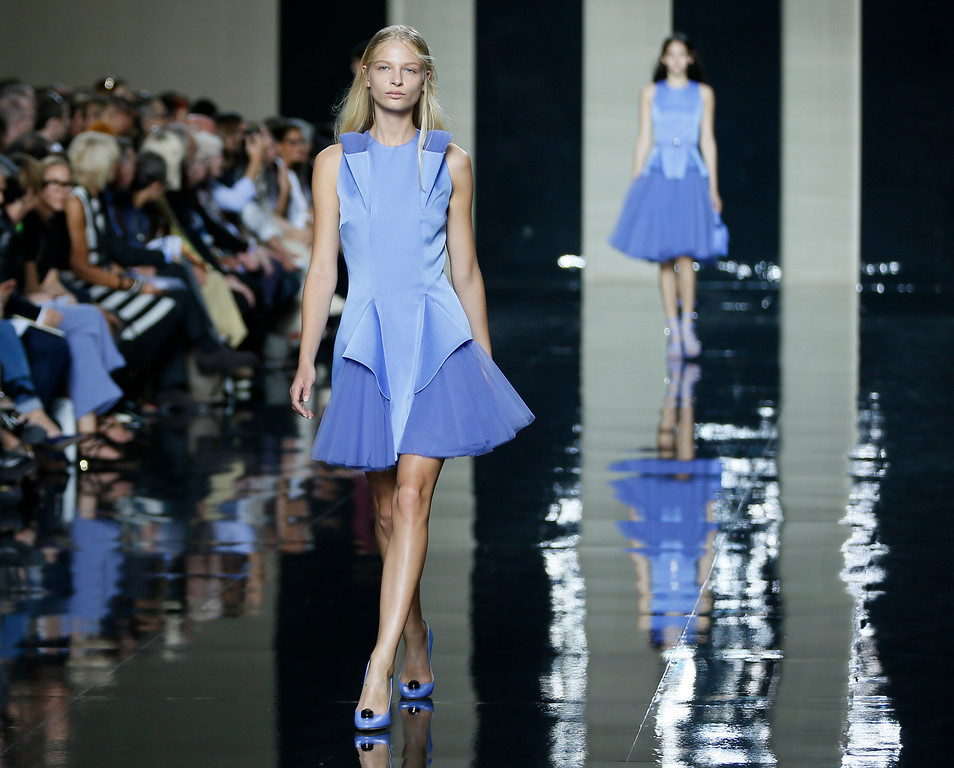 . Models wear outfits by designer Christopher Kane during his Spring/Summer 15 show at London Fashion Week in London, Monday, Sept. 15, 2014. (AP Photo/Alastair Grant)