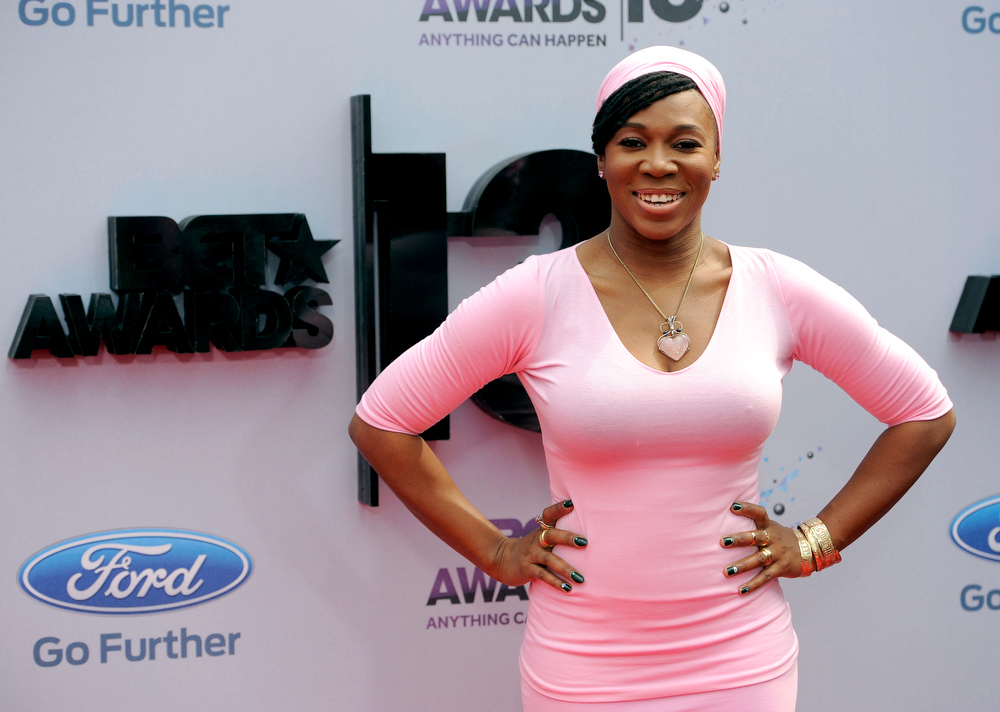 Description of . India Arie arrives at the BET Awards at the Nokia Theatre on Sunday, June 30, 2013, in Los Angeles. (Photo by Chris Pizzello/Invision/AP)