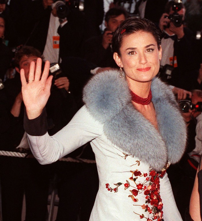 ". US movie star Demi Moore waves to the crowd as she arrives  at the Festival Palace in Cannes on Saturday May 10, 1997 to attend the screening of US actor Johnny Depp\'s first movie as director ""The Brave\"" which is presented today to the jury of the 50 International Cannes Film festival. (AP PHOTO/Remy de la Mauviniere)"