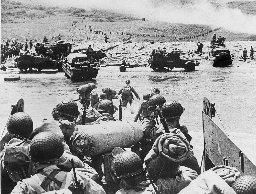 . American soldiers and supplies arrive on the shore of the French coast of German-occupied Normandy during the Allied D-Day invasion on June 6, 1944 in World War II.   (AP Photo)