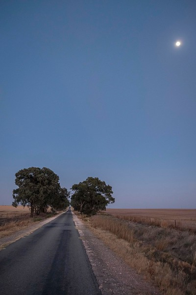 Full moon before sunrise. The Mallee is an ill-defined region of the Australian state of Victoria. The district covers the most northwesterly district in the state bounded by the South Australian and New South Wales borders and is cross crossed by kilometres of long straight roads.