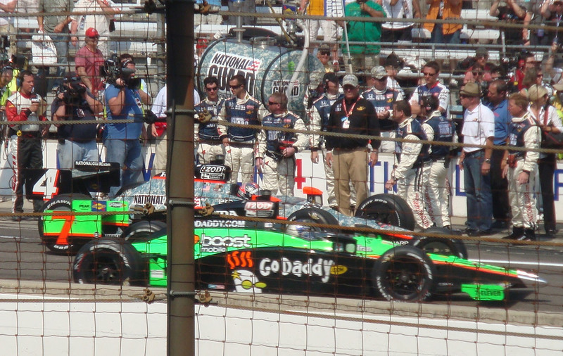 Danica Patrick pulls into her pit after the race, with Dan Wheldon already in his.