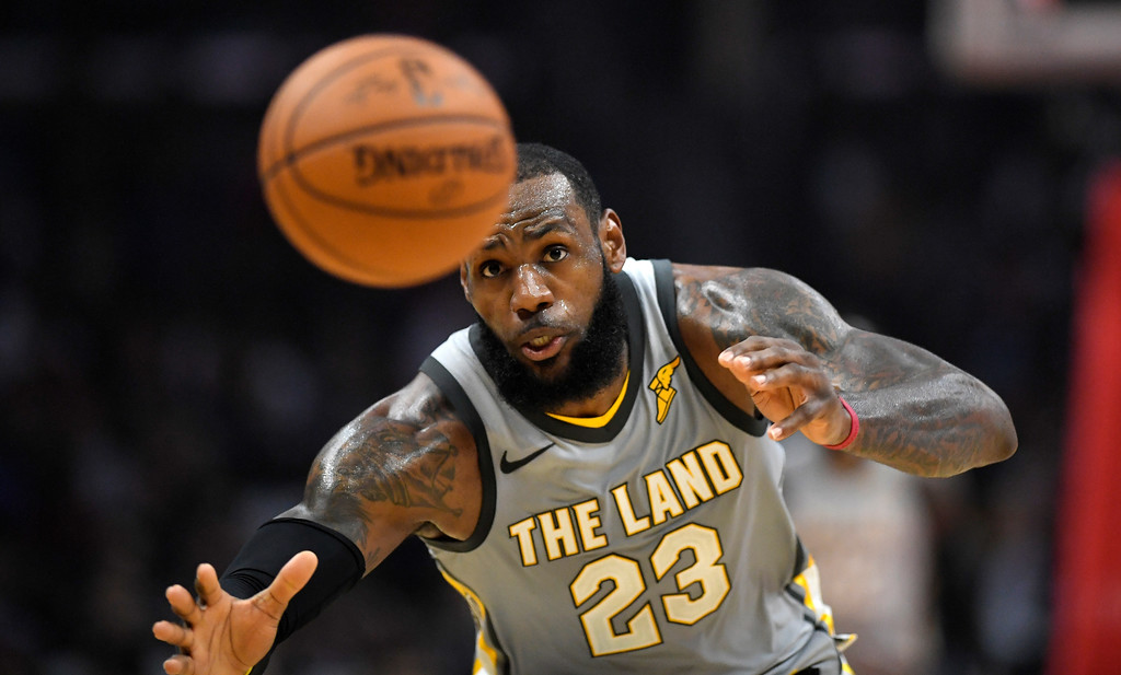 . Cleveland Cavaliers forward LeBron James reaches to try to intercept an inbound pass during the first half of the team\'s NBA basketball game against the Los Angeles Clippers, Friday, March 9, 2018, in Los Angeles. (AP Photo/Mark J. Terrill)