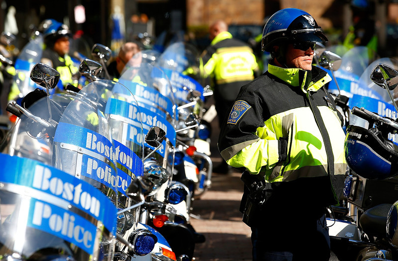 . Boston Police officers patrol Boylston Street near the finish line of the Boston Marathon prior to the start of the B.A.A. Tribute Run on April 19, 2014 in Boston, Massachusetts.  (Photo by Jared Wickerham/Getty Images)