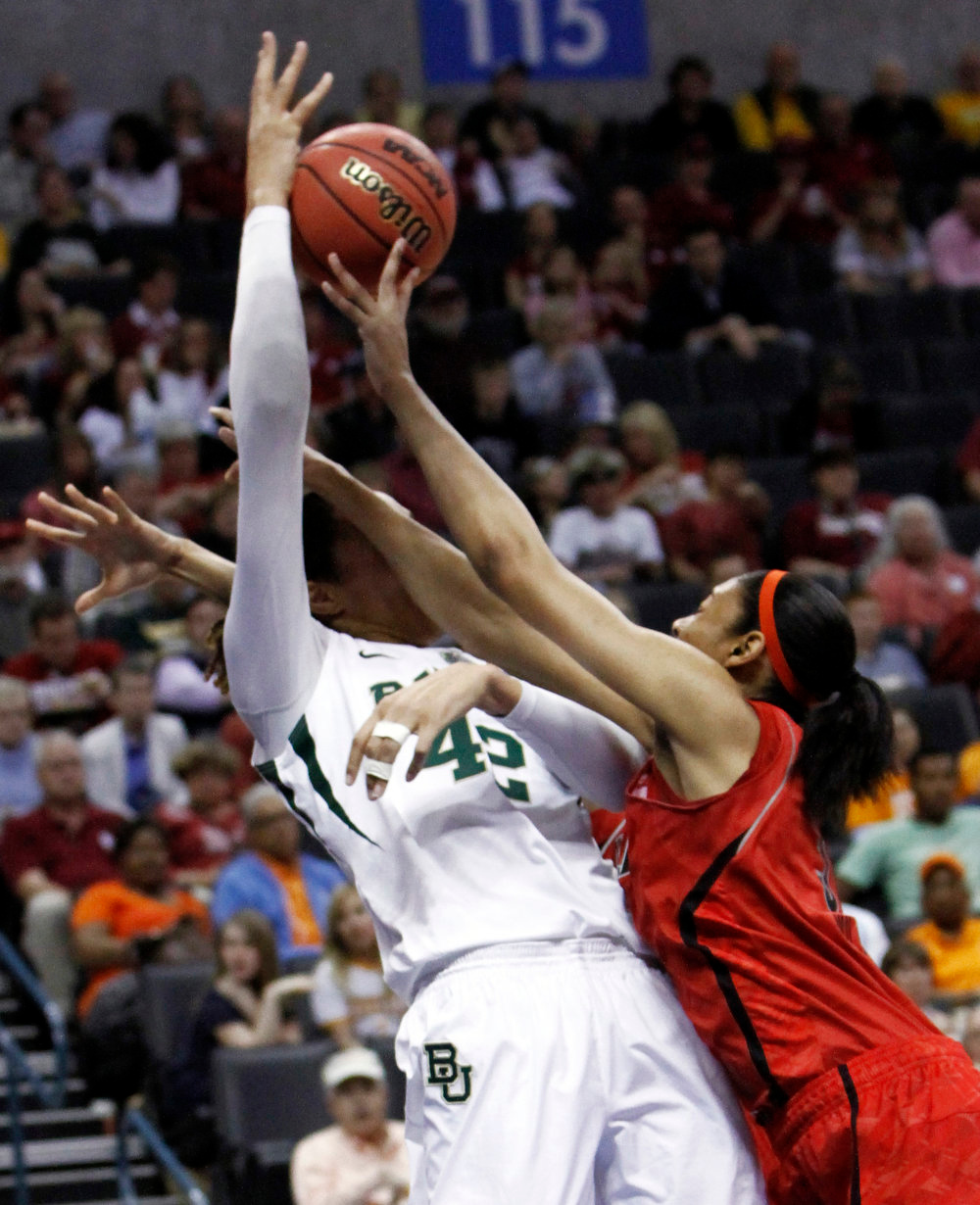 . Louisville\'s Sheronne Vails, right, blocks a pass by Baylor\'s Brittney Griner, left, during a regional semifinal game in the women\'s NCAA college basketball tournament in Oklahoma City, Sunday, March 31, 2013.  (AP Photo/Alonzo Adams)