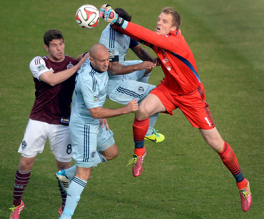 . Kansas City goalie Eric Kronberg (1) punched the ball away from Colorado midfielder Dillon Powers (8) in the second half. Sporting Kansas City defeated the Colorado Rapids 3-2 Saturday evening, March 29, 2014 at Dick\'s Sporting Goods Stadium in Commerce City.  (Photo by Karl Gehring/The Denver Post)