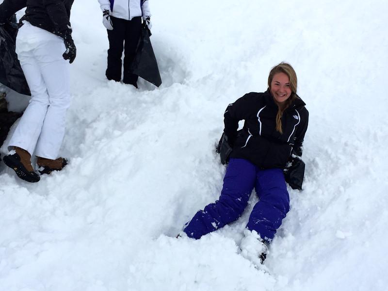 Ema sliding down the hill on a trash bag