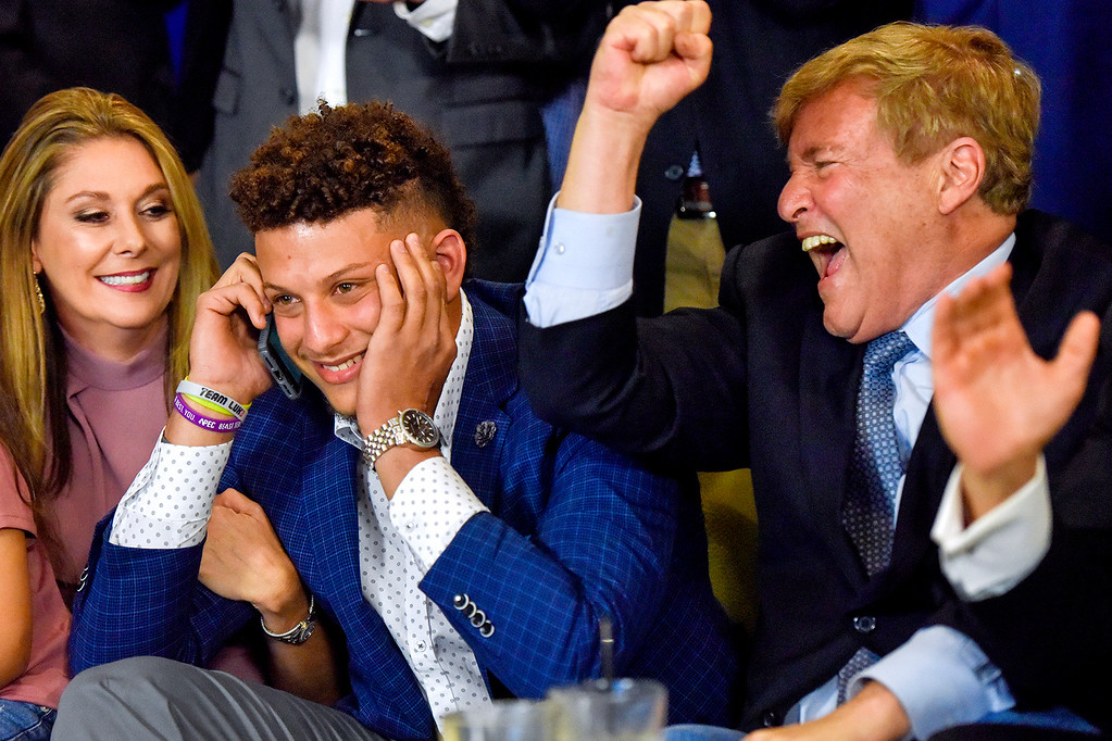. Randi Martin, Patrick Mahomes and Leigh Steinberg react while Mahomes is on a call with the Kansas City Chiefs, during an NFL football draft watch party in Tyler, Texas, Thursday, April 27, 2017. Texas Tech quarterback Mahomes was the 10th overall pick by the Chiefs, after a trade with the Buffalo Bills. (Chelsea Purgahn/Tyler Morning Telegraph via AP)