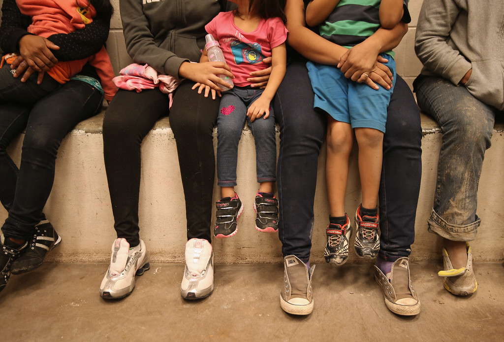 . Women and children sit in a holding cell at a U.S. Border Patrol processing center after being detained by agents near the U.S.-Mexico border on September 8, 2014 near McAllen, Texas.  (Photo by John Moore/Getty Images)