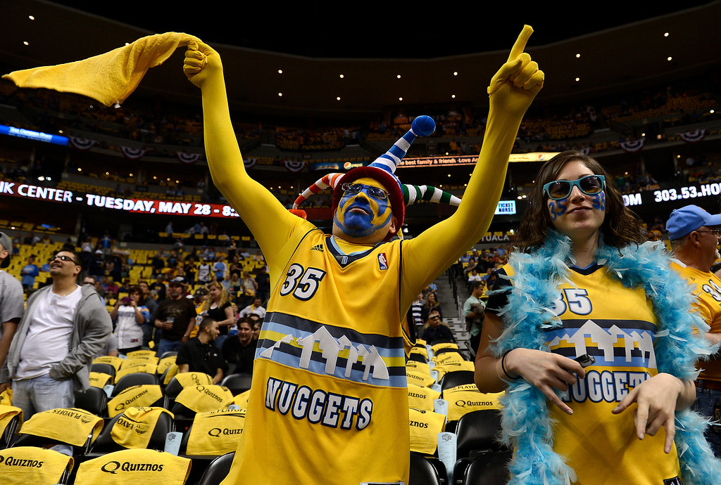 . DENVER, CO. - APRIL 20: Floyd Martinez, 29, and Vanessa Escatel, 26, both from Brighton, Colo. cheer was the Nuggets take the floor. The Denver Nuggets took on the Golden State Warriors in Game 1 of the Western Conference First Round Series at the Pepsi Center in Denver, Colo. on April 20, 2013. (Photo by John Leyba/The Denver Post)