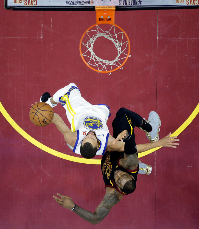 . Golden State Warriors\' Stephen Curry goes to the basket against Cleveland Cavaliers\' LeBron James during the second half of Game 3 of basketball\'s NBA Finals, Wednesday, June 6, 2018, in Cleveland. (AP Photo/Carlos Osorio, Pool)