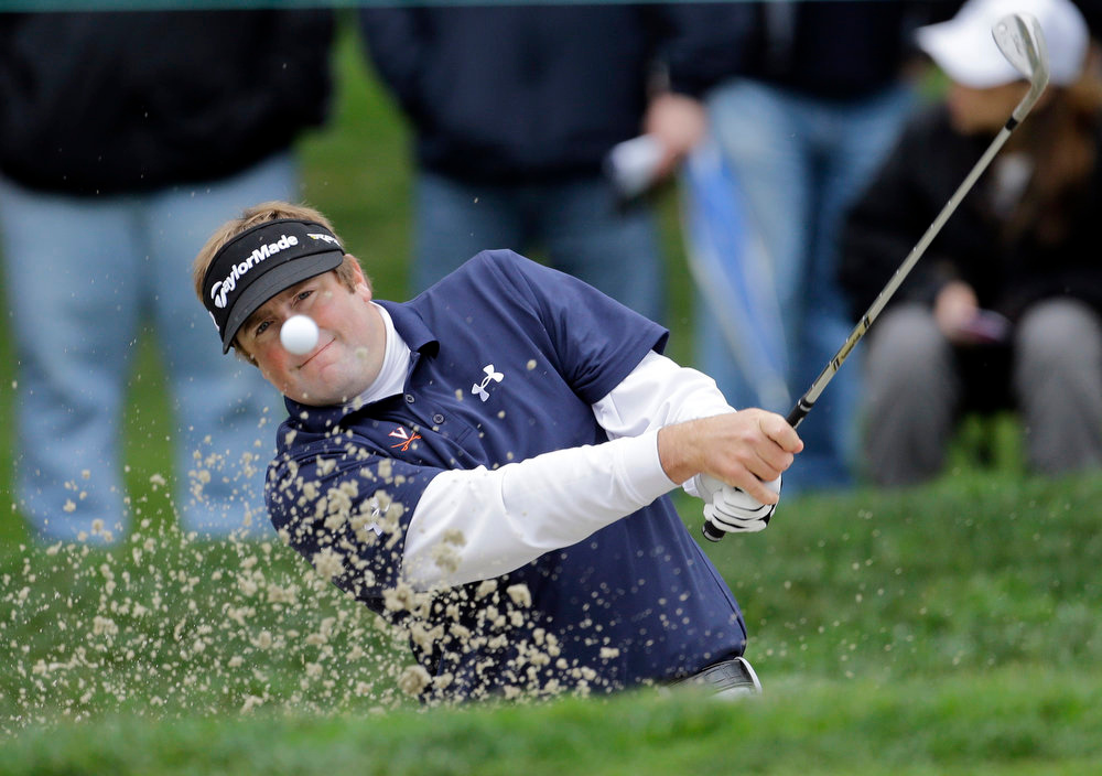 . Steve Marino hits from the bunker on the first hole of the South Course at Torrey Pines during the third round of the Farmers Insurance Open golf tournament on Sunday, Jan. 27, 2013, in San Diego. (AP Photo/Lenny Ignelzi)