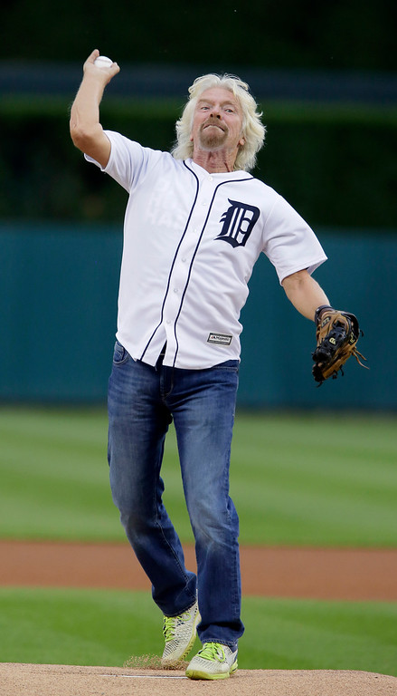 . Sir Richard Branson, president and founder of Virgin Atlantic, throws out a ceremonial first pitch before the Detroit Tigers game against the Cleveland Indians at Comerica Park Friday, June 12, 2015, in Detroit. Branson was in town to kick off Virgin Atlantics new non-stop route from Detroit to London. (AP Photo/Duane Burleson)