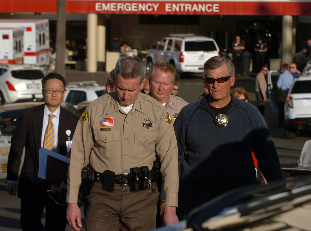 . San Bernardino County Sheriff John McMahon dropes his head as he walks out of the ER at Loma Linda University Medical Center to report to the media that one police officer was killed and one injured by Christopher Dorner in the Big Bear area in Loma Linda February 12, 2013.  ON13-Dorner-01-TRC (Thomas R. Cordova/Staff Photographer)