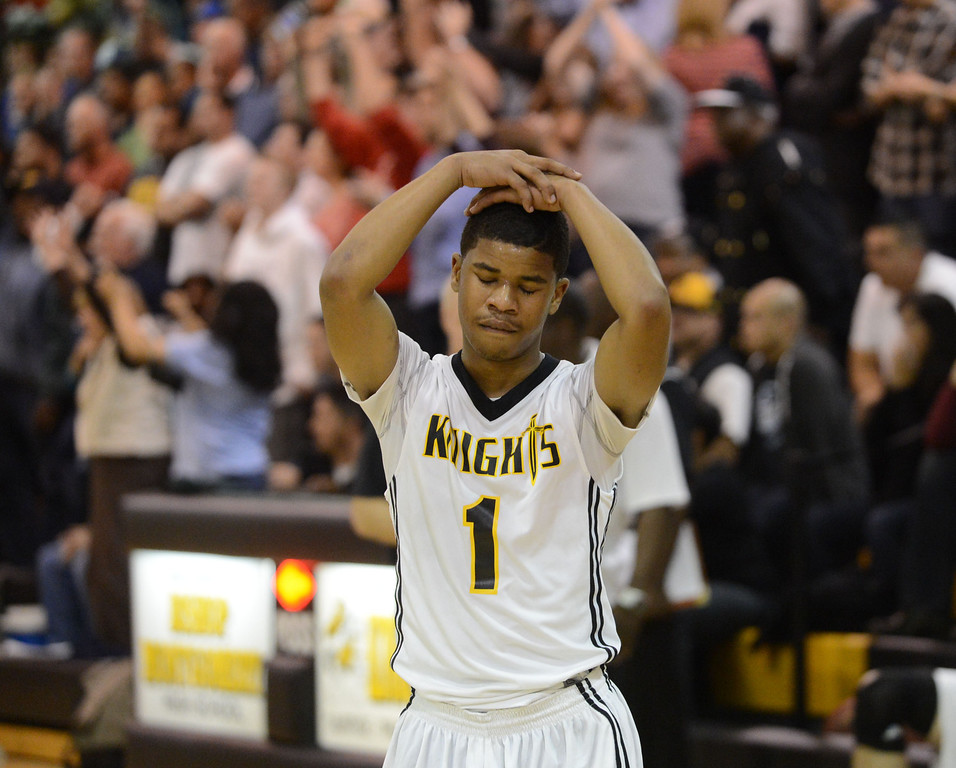 . Bishop Montgomery\'s Larry Taylor III (1) reacts as time runs out against La Verne Lutheran in a CIF SS Division IV-AA semifinal game in Torrance Friday night. Lutheran stunned Bishop Montgomery 63-59, ending their unbeaten season. 20130222 Photo by Steve McCrank / Staff Photographer